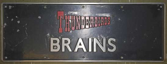 Locomotive nameplate, 'Thunderbirds Brains'. National Railway Museum, York. ThunderbirdsTM and © ITC Entertainment Group Limited 1964, 1999 and 2015. Licensed by ITV Ventures Limited. All rights reserved.
