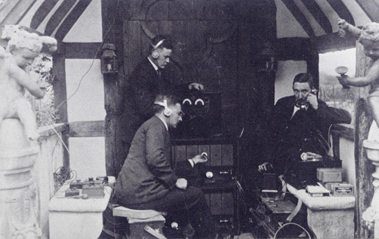 All the paraphernalia of the BBC: wireless engineers take up station outside the front door of Foyle Riding. A G D West is in the foreground, P P Eckersley at right. (Copyright unknown)