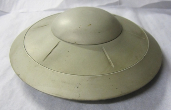 An original model of a flying saucer from Earth vs. the Flying Saucers © The Ray and Diana Harryhausen Foundation