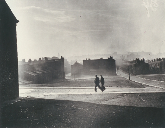Two figures walk by cleared blitz site, Liverpool, 21 November 1949, White, Daily Herald Archive, National Media Museum Collection / SSPL