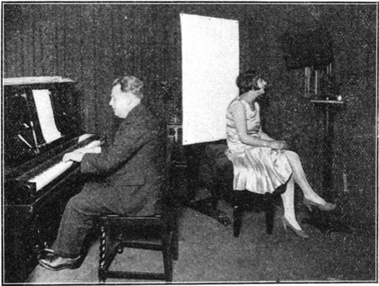 Miss Lulu Stanley seated before the television transmitter in the Baird studio on the occasion of the inaugural broadcast through 2LO on 30 September 1929 (Television magazine, October 1929)
