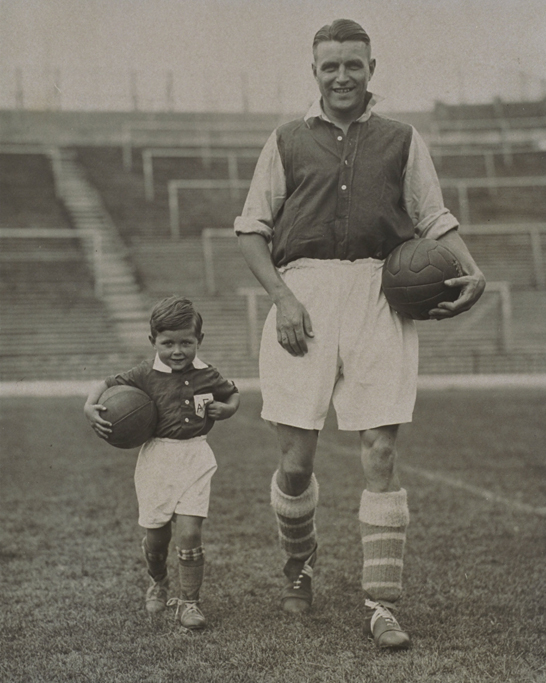 Arsenal FC in training, 1934 © Daily Herald / National Media Museum, Bradford / SSPL A photograph of England and Arsenal Captain Eddie Hapgood (1908 - 1973) and his son as the Arsenal mascot, at Highbury, London.