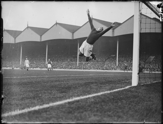 Manchester City goalkeeper Frank Swift makes a save against Arsenal, 1934, George Woodbine © Daily Herald / National Media Museum, Bradford / SSPL