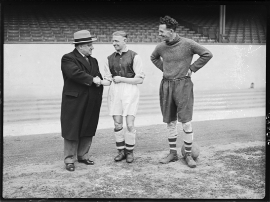 Arsenal pay £9000 for player George Drury, 1938, Harold Tomlin © Daily Herald / National Media Museum, Bradford / SSPL A photograph of Arsenal Football Club Manager, George Allison and centre half, Herbie Roberts, greeting George Drury at his arrival at Arsenal's ground Highbury. Drury was signed from Sheffield Wednesday for £9000.