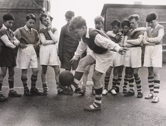 Skillful footwork at after-school football training, 1957, National Media Museum, Bradford / SSPL © Daily Herald / Fox Photos