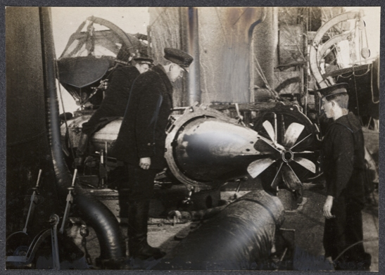Inspecting a torpedo, c. 1915, unknown photographer © National Media Museum, Bradford / SSPL. Creative Commons BY-NC-SA