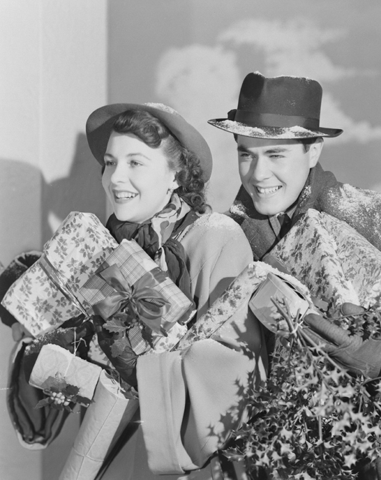 Couple carrying Christmas presents, c.1950, Photographic Advertising Limited © National Media Museum, Bradford / SSPL. Creative Commons BY-NC-SA