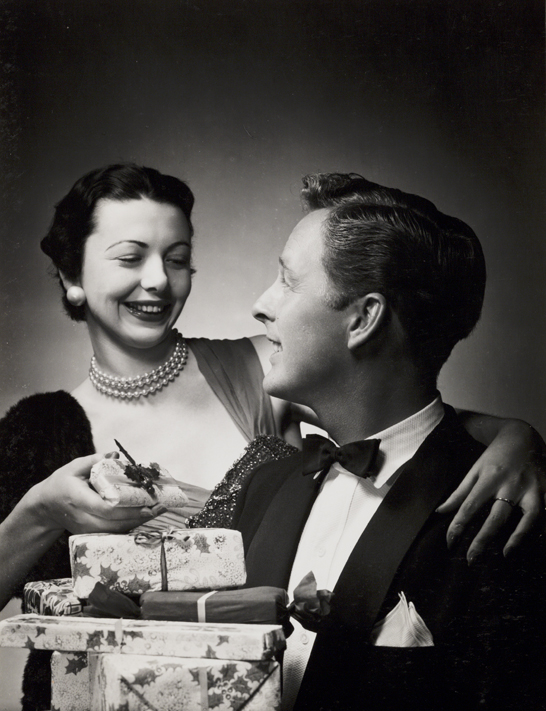 Couple with Christmas presents, c. 1958, Photographic Advertising Limited © National Media Museum, Bradford / SSPL. Creative Commons BY-NC-SA
