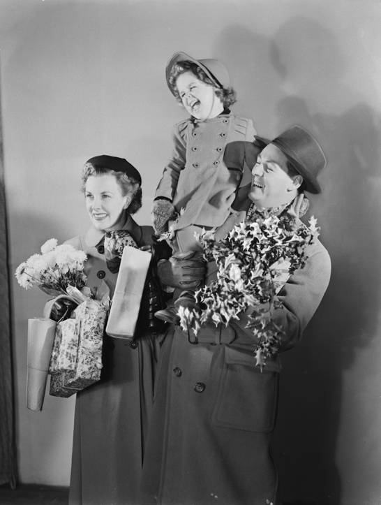 Family carrying Christmas presents, 1950, Photographic Advertising Limited © National Media Museum, Bradford / SSPL. Creative Commons BY-NC-SA