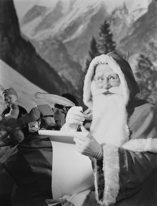 Father Christmas checking his list, 1950, Photographic Advertising Limited © National Media Museum, Bradford / SSPL. Creative Commons BY-NC-SA