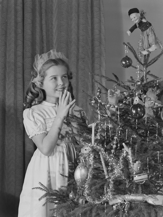 Little girl looking at Christmas tree, c. 1950, Photographic Advertising Limited © National Media Museum, Bradford / SSPL. Creative Commons BY-NC-SA