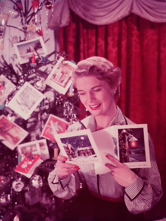 Woman reading Christmas cards, c.1950, Photographic Advertising Limited © National Media Museum, Bradford / SSPL. Creative Commons BY-NC-SA