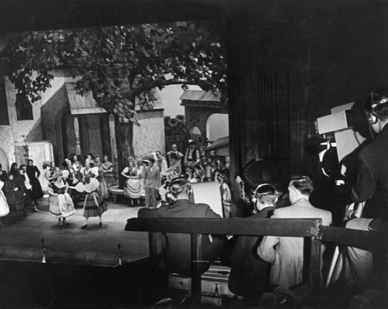 Televised production of Magyar Melody at His Majesty's Theatre, 27 March 1939 © Daily Herald / National Media Museum, Bradford / SSPL. Creative Commons BY-NC-SAMagyar Melody was the first musical to be broadcast directly from a theatre and shown on television. Captions on screen introduced the television audience to the actors and actresses.