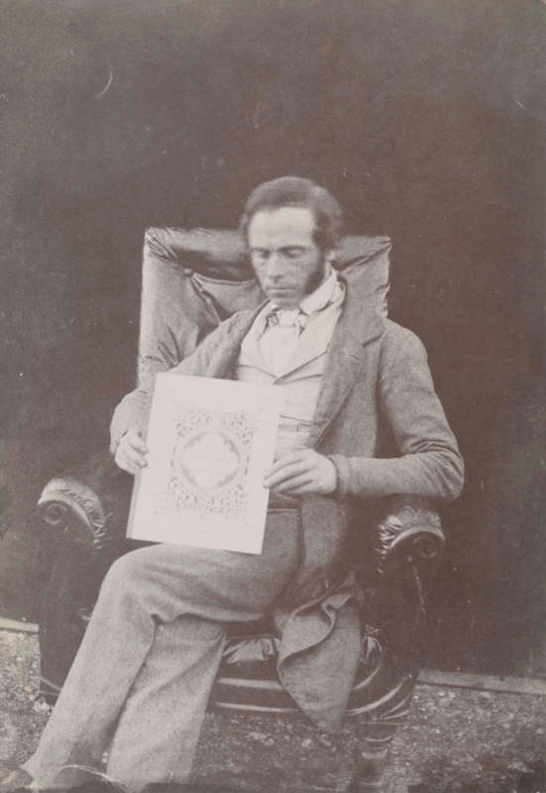 Nicolass Henneman holding a copy of The Pencil of Nature, 1844, William Henry Fox Talbot © National Media Museum, Bradford / SSPL. Creative Commons BY-NC-SA